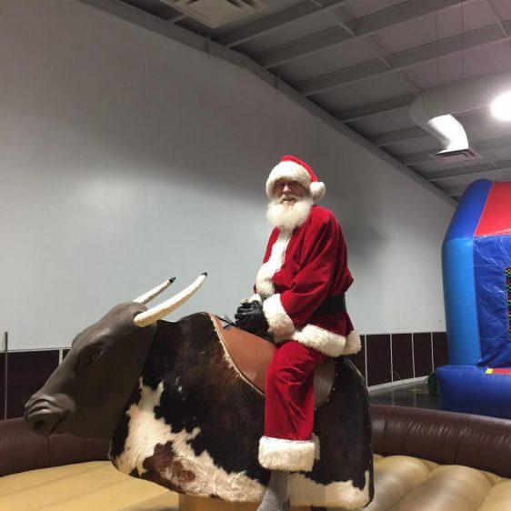 Santa riding a bull