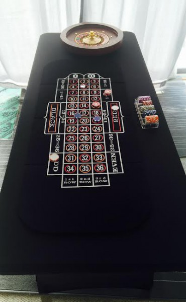 Roulette Table with Black Spandex skirting and spin wheel